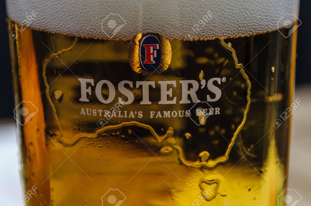 Close up of a glass of Foster's with foam - 58702255
