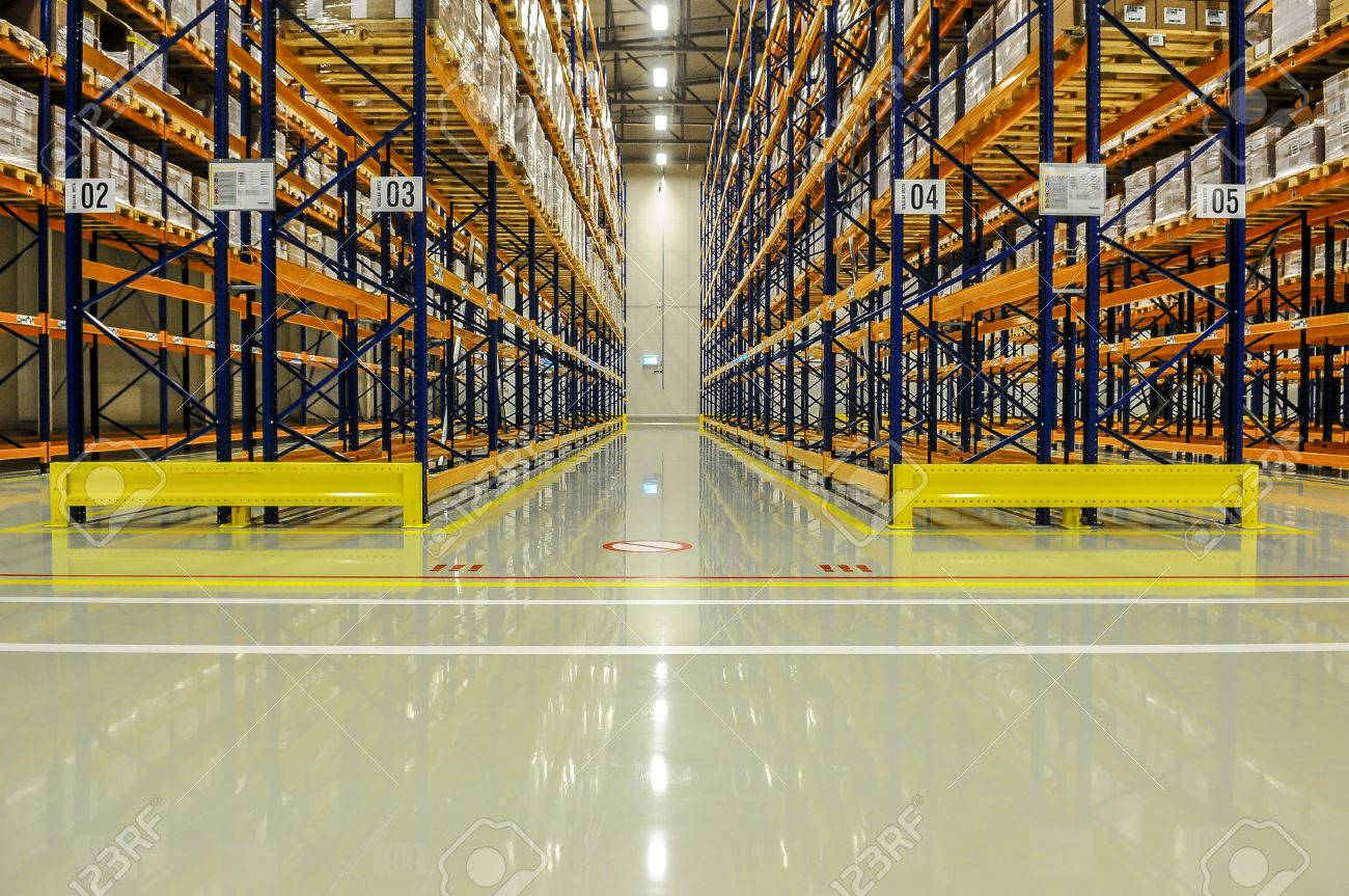 View through the racks of a large warehouse - 58702258