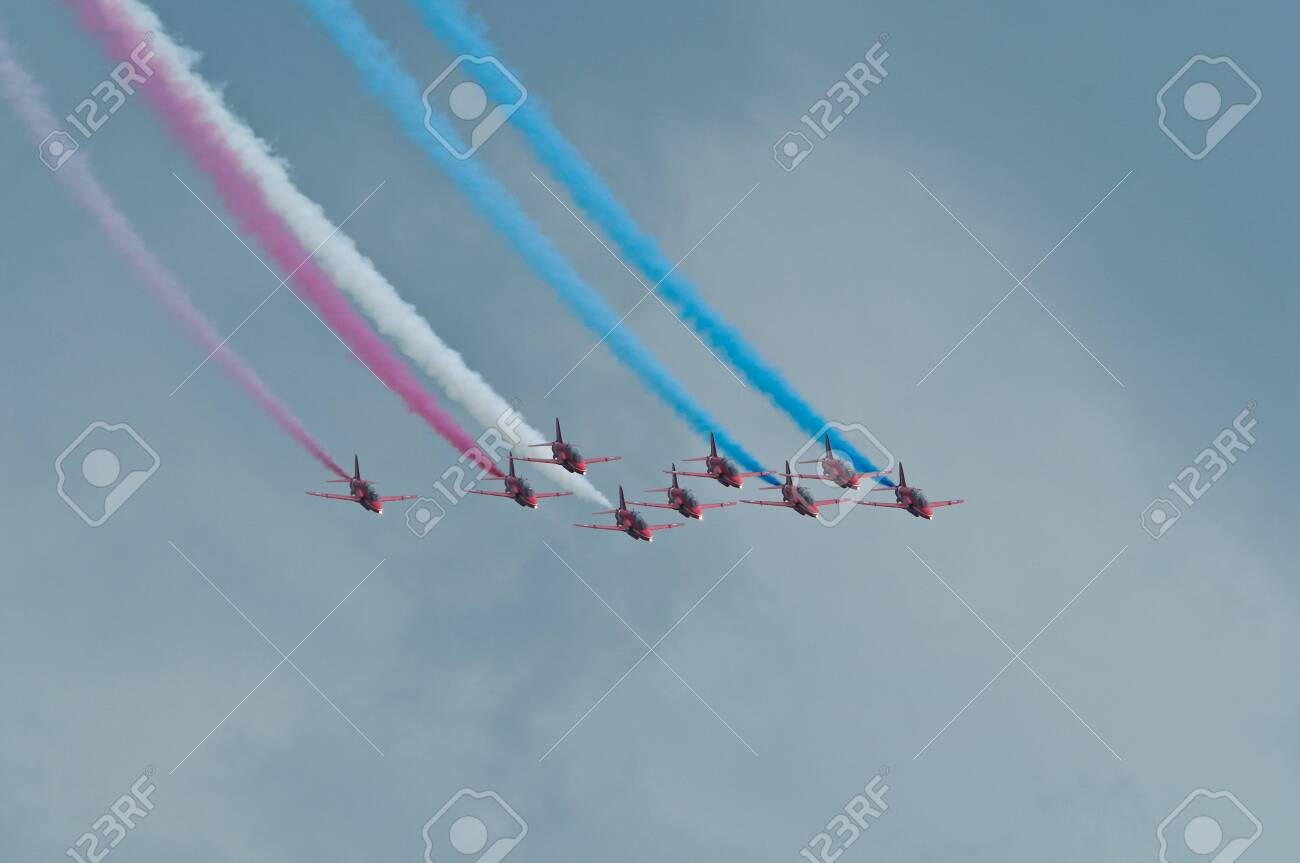 Maribor, Slovenia - June 3 2011: Red Arrows Aerobatic Display Team performing at public airshow in Maribor. The Red Arrows are the official display team of Royal Air Force. Free admittance to show. - 137008555