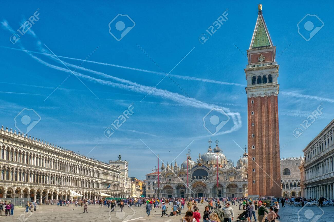 Venice, Italy, April 17 2019: St Marks Square in Venice, Italy, Piazza San Marco in Venezia with the Basilica and bell tower attracts tourists from across the world - 137009120