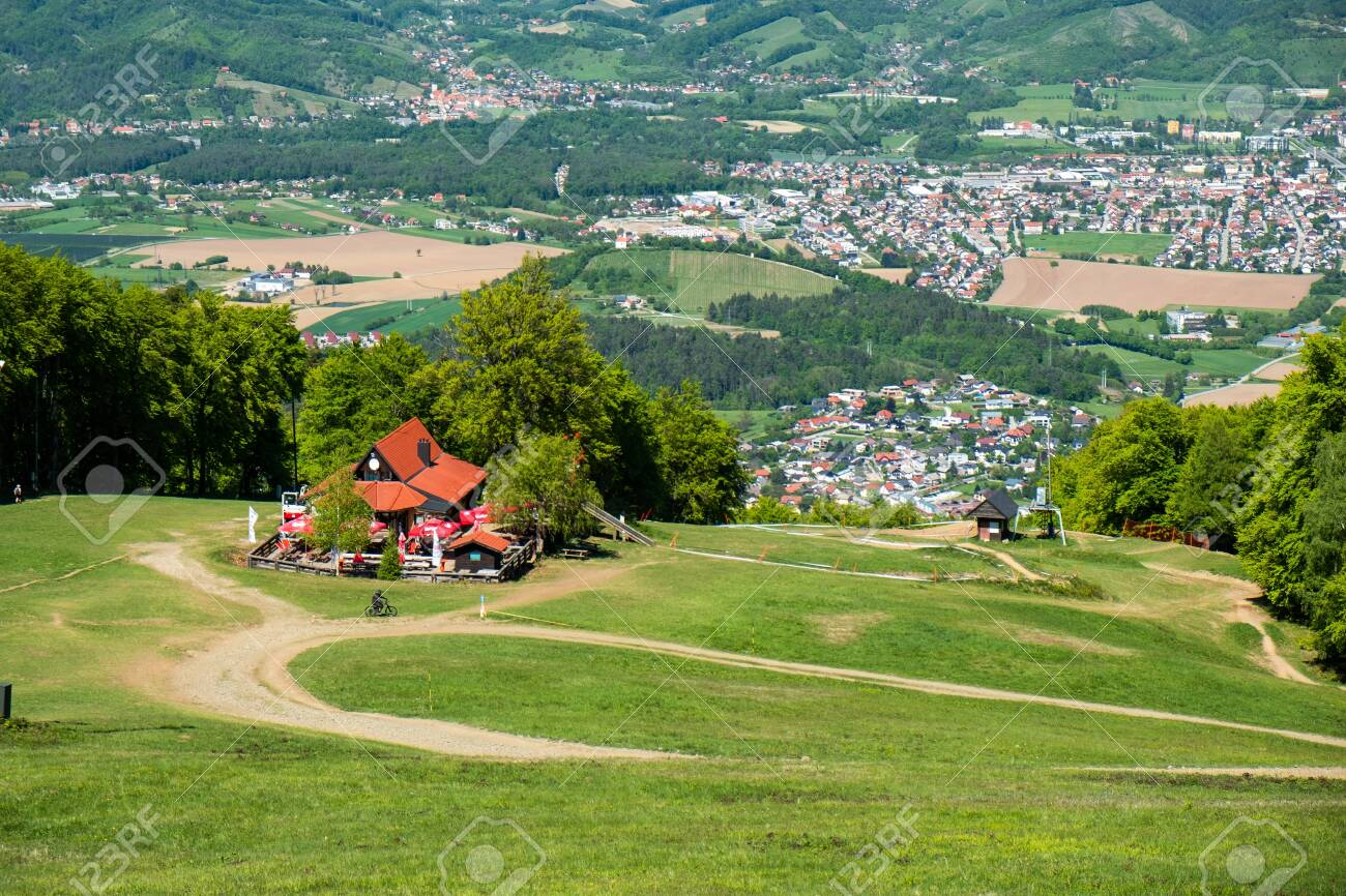 Maribor, Slovenia - 02 May 2019: Mountain hut Luka on the ski slopes of Pohorje with Maribor offers rest and refreshments to hikers and skiers while offering a magnificent view on Maribor, Slovenia - 137009418