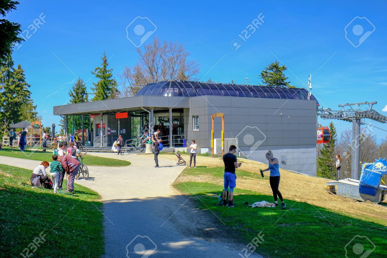 Maribor, Slovenia - May 2, 2019: People walking at Bellevue, the upper station of Pohorska vzepnjaca cable car line, transporting hikers bicyclist to the top of Pohorje - 137009420