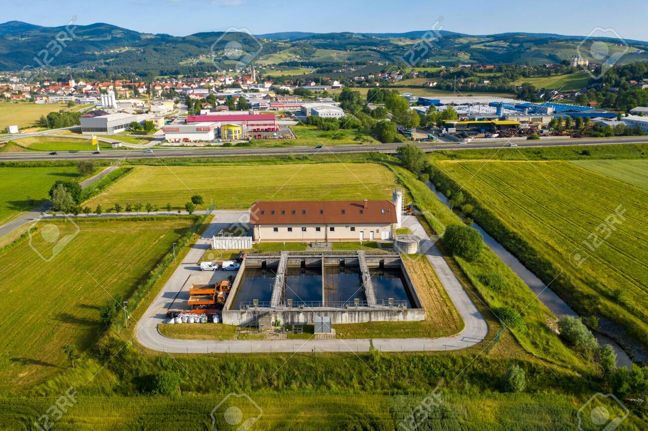 Slovenska Bistrica, Slovenia - June 9 2019: Aerial view of wastewater and sewage treatment plant in the outskirts of Slovenska Bistrica. - 137009825