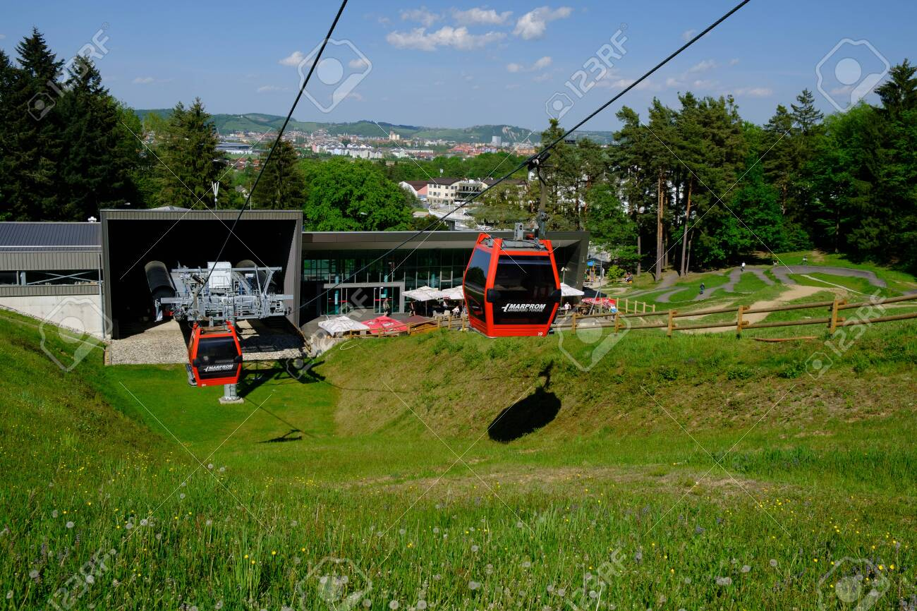 Maribor, Slovenia - May 2, 2019: Pohorska vzpenjaca cable car at lower station in Maribor, Slovenia, a popular destination for hiking and downhill mountain biking - 137009931