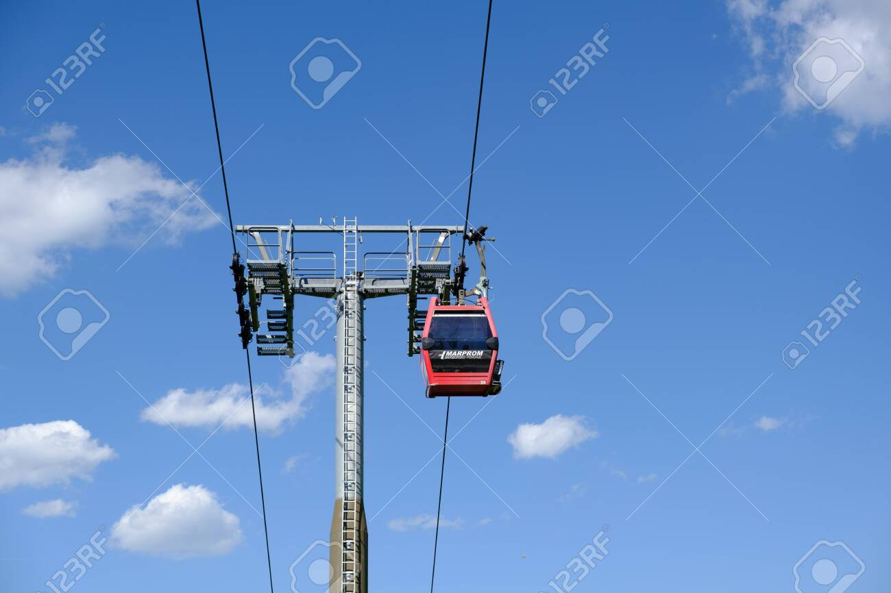 Maribor, Slovenia - May 2 2019: Red cabins of the Pohorska vzpenjaca cable car in Maribor, Slovenia connect the top of Pohorje mountain with the city - 137010528