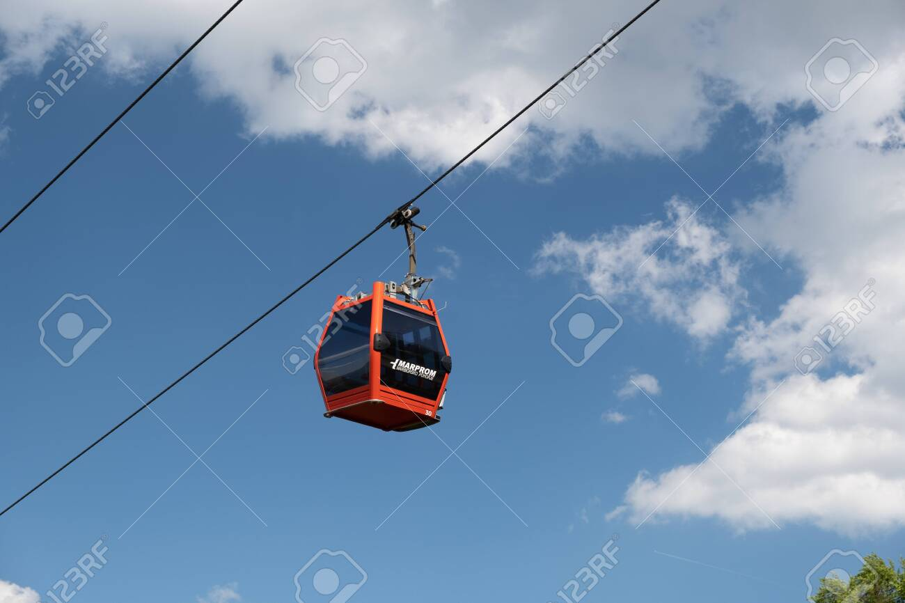 Maribor, Slovenia - May 2 2019: Red cabins of the Pohorska vzpenjaca cable car in Maribor, Slovenia connect the top of Pohorje mountain with the city - 137010531