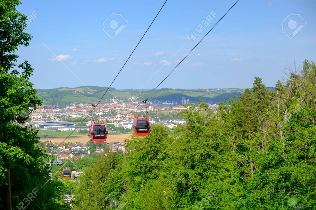 Maribor, Slovenia - May 2 2019: Red cabins of the Pohorska vzpenjaca cable car in Maribor, Slovenia connect the top of Pohorje mountain with the city - 137010532