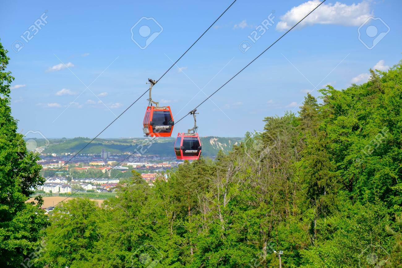 Maribor, Slovenia - May 2 2019: Red cabins of the Pohorska vzpenjaca cable car in Maribor, Slovenia connect the top of Pohorje mountain with the city - 137010533
