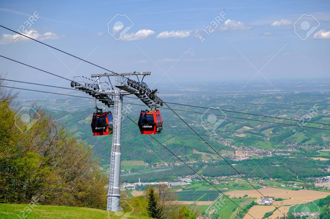 Maribor, Slovenia - May 2 2019: Red cabins of the Pohorska vzpenjaca cable car in Maribor, Slovenia connect the top of Pohorje mountain with the city - 137010543