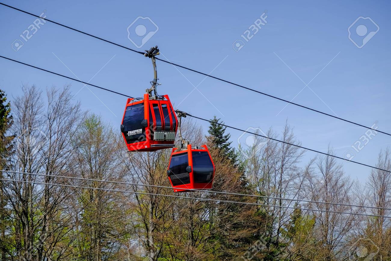 Maribor, Slovenia - May 2 2019: Red cabins of the Pohorska vzpenjaca cable car in Maribor, Slovenia connect the top of Pohorje mountain with the city - 137010546
