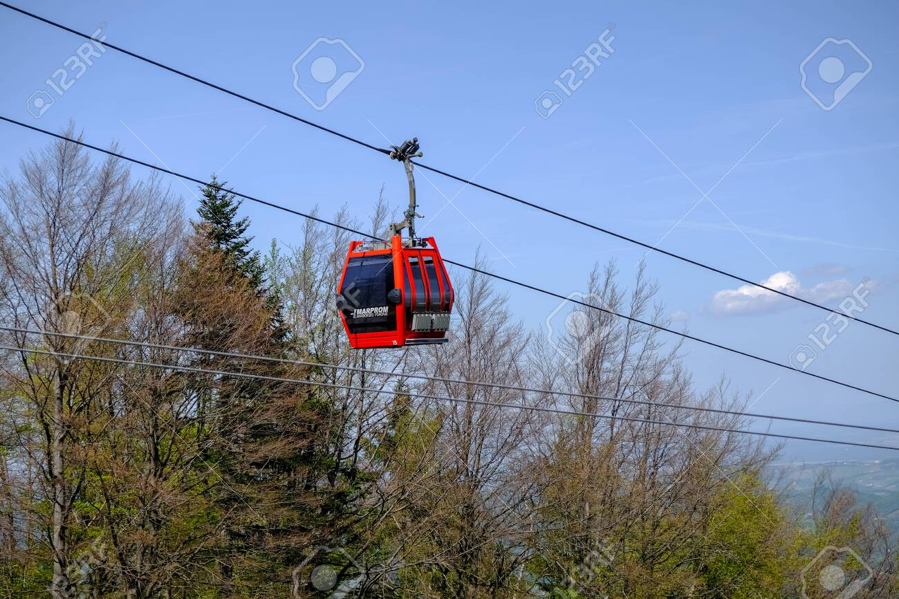 Maribor, Slovenia - May 2 2019: Red cabins of the Pohorska vzpenjaca cable car in Maribor, Slovenia connect the top of Pohorje mountain with the city - 137010548