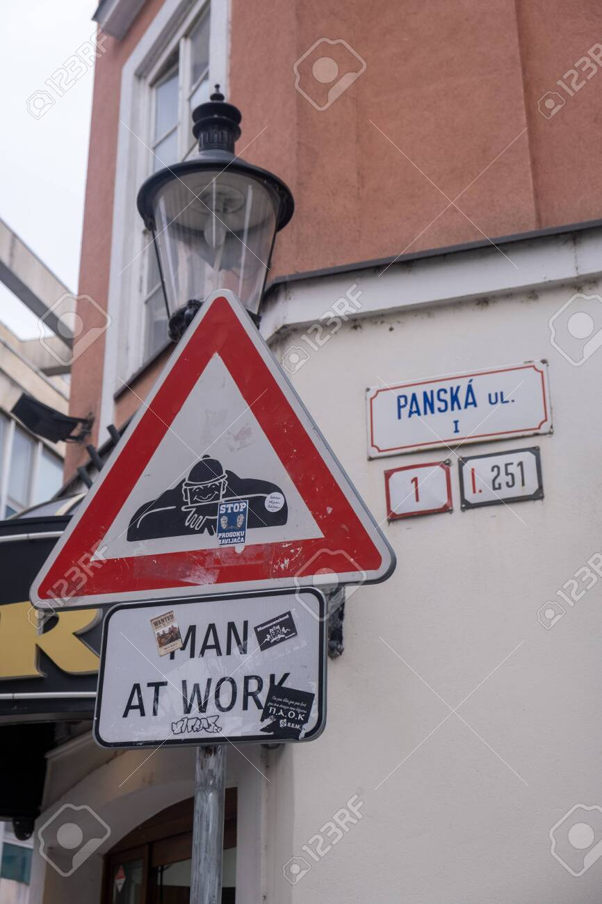 Bratislava, Slovakia - Spet. 25 2019: Man at work signpost in the streets of Bratislava, Slovakia, street worker in the sewers warning sign - 137010820