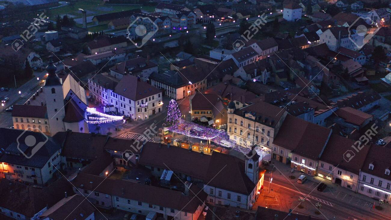 Slovenska Bistrica, Slovenia - Dec 25 2019: Aerial view of Christmas fair on main square in Slovenska Bistrica, a small medieval town in Slovenia with wooden shop stands, closed on Christmas eve - 137012199