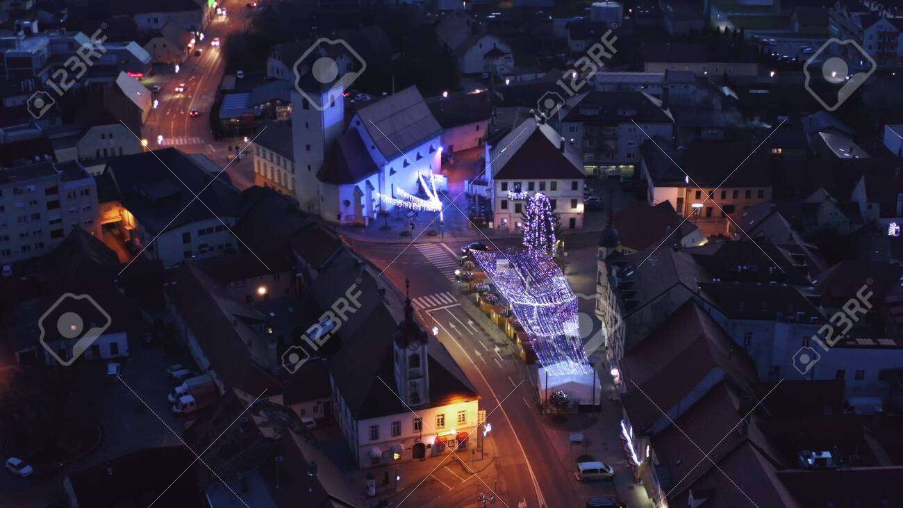 Slovenska Bistrica, Slovenia - Dec 25 2019: Aerial view of Christmas fair on main square in Slovenska Bistrica, a small medieval town in Slovenia, cars pass by on main street - 137012208