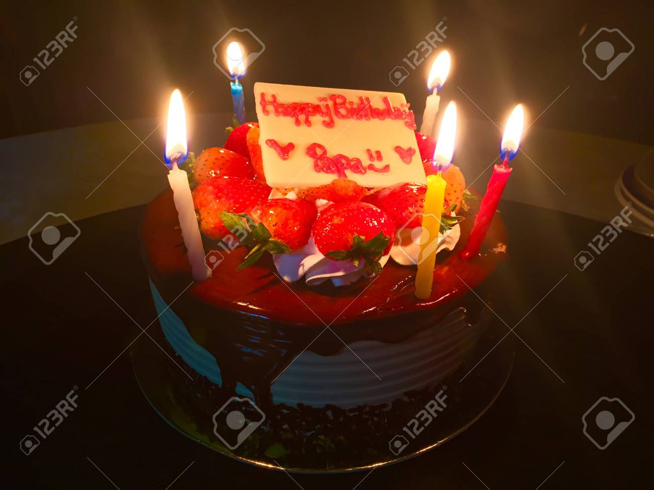 Happy Birthday Dad Strawberry Cake With Candle Light In The Dark Stock Photo