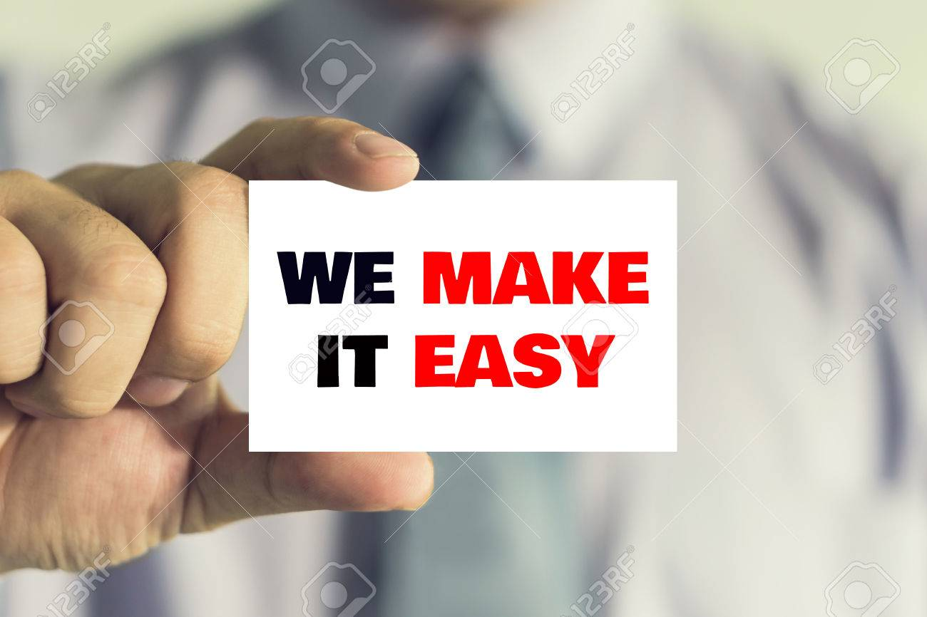 Businessman Showing Business Card With WE MAKE IT EASY Message ...