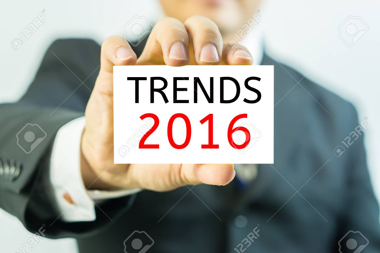 Asian business man showing business card trends 2016 message asian business man showing business card trends 2016 message on the card shown by a colourmoves