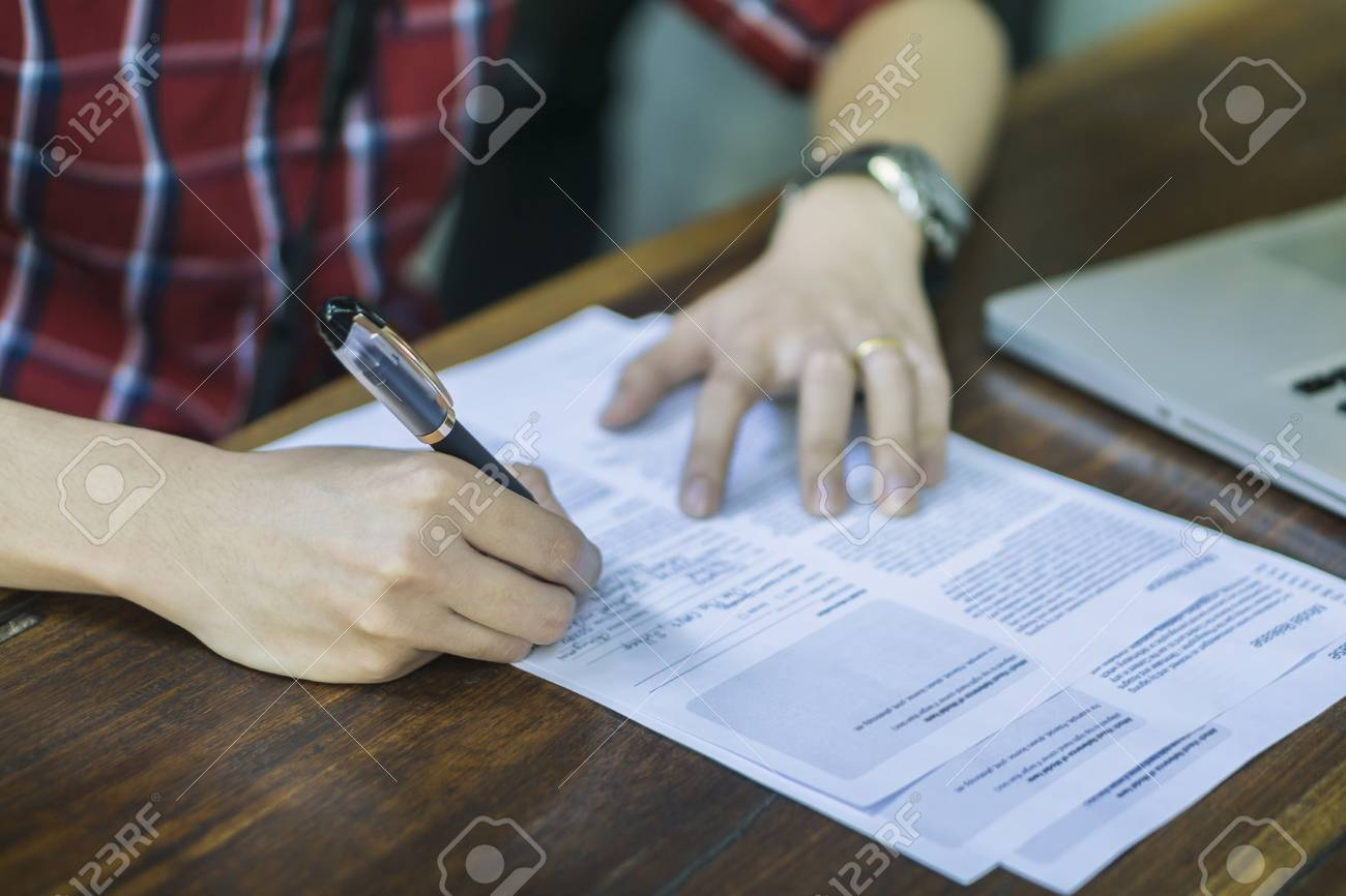 close-up of businessperson signing contract,man writing paper