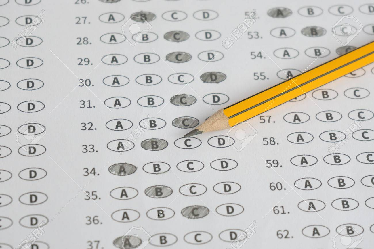 a pencil sitting on a test bubble sheet optical form of an