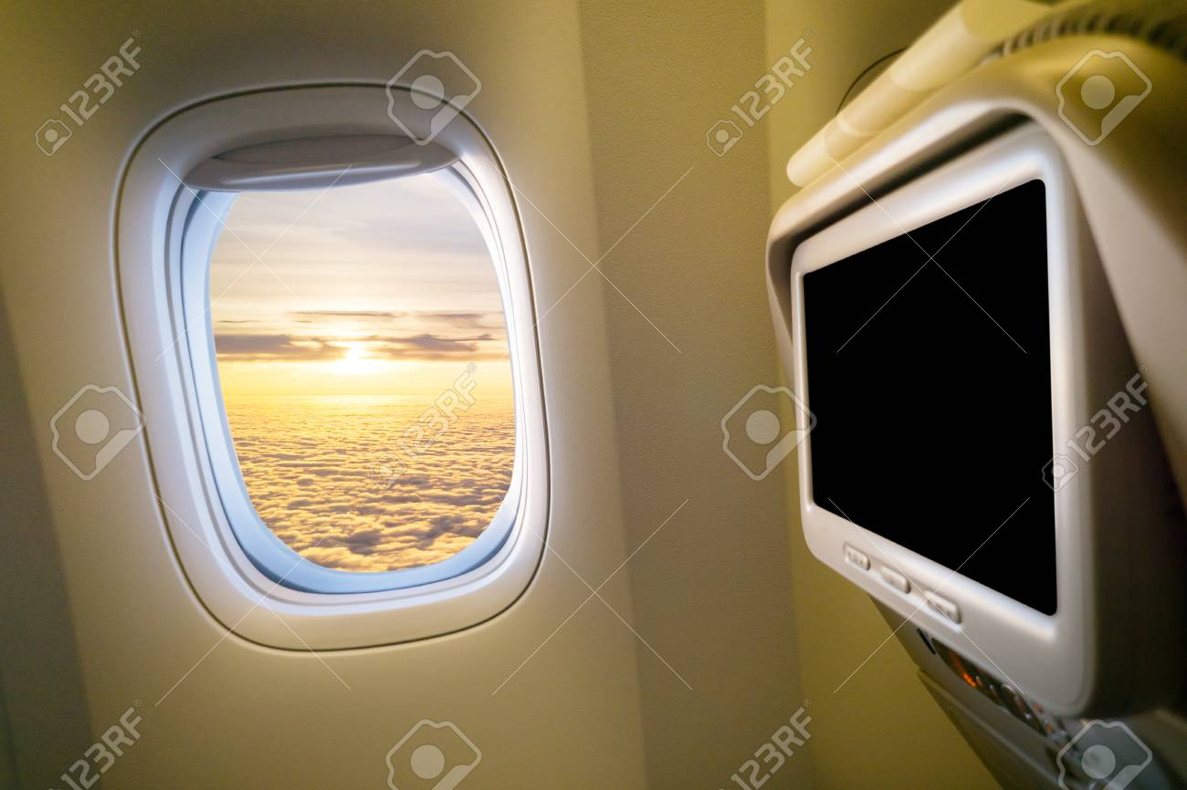 clouds and sky as seen through window of an aircraft plane interior