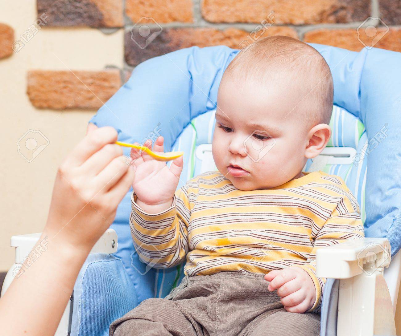 Eating little boy is looking very angry and annoyed Stock Photo - 17181972