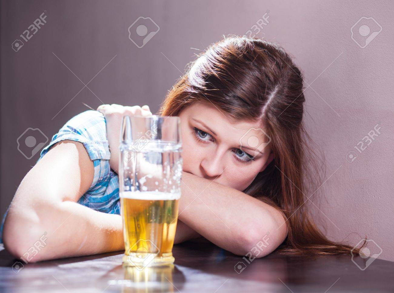 disgusting looking woman with a glass of beer Stock Photo - 17561163