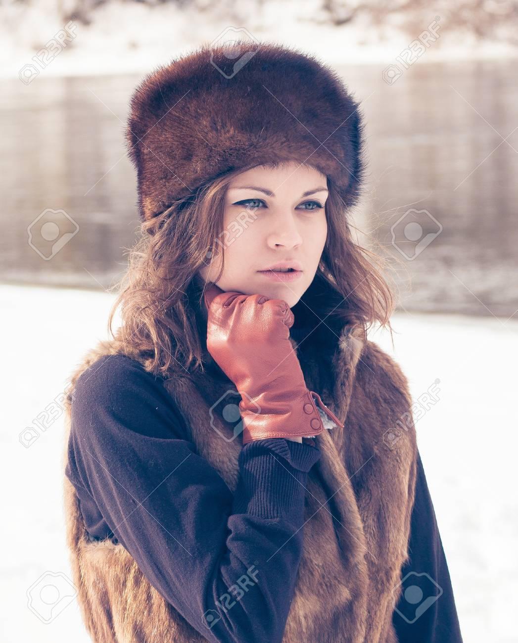 Portrait Of A Beautiful Girl In A Fur Hat