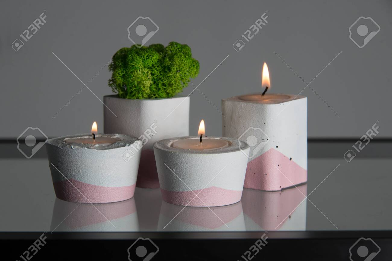 Candles And Moss In White And Pink Concrete Candle Holders Stock Photo Picture And Royalty Free Image Image 141462615