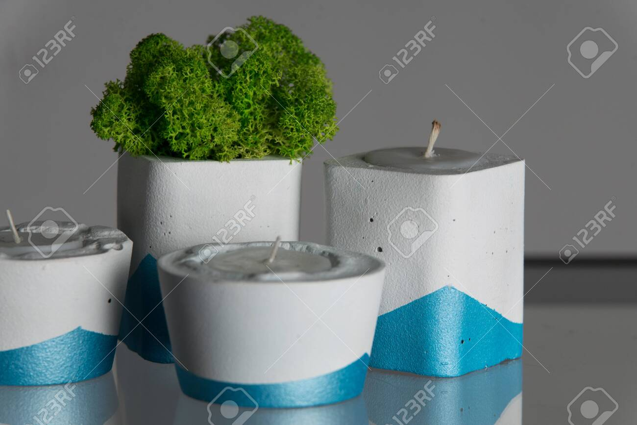 Candles And Moss In White And Blue Concrete Candle Holders Stock Photo Picture And Royalty Free Image Image 141463717
