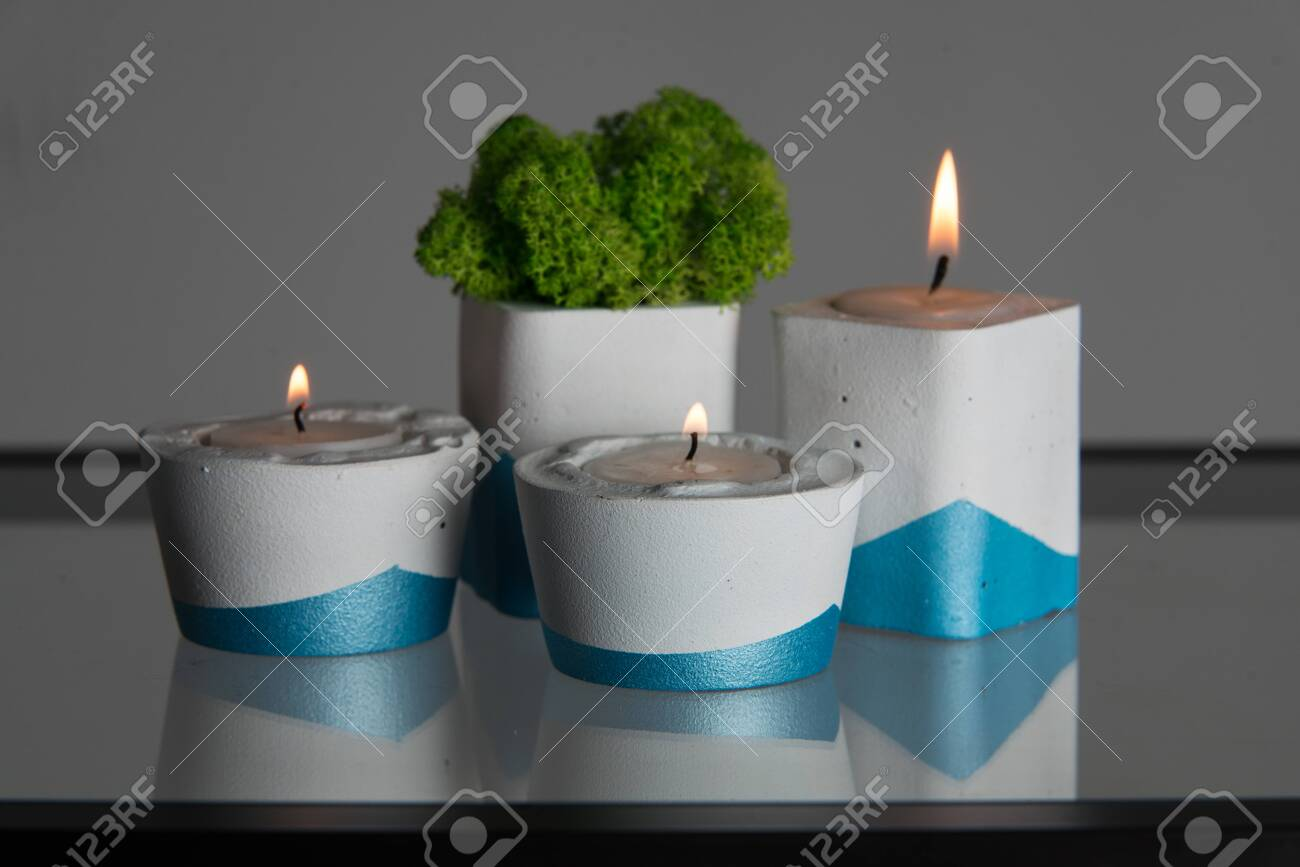 Candles And Moss In White And Blue Concrete Candle Holders Stock Photo Picture And Royalty Free Image Image 141757341