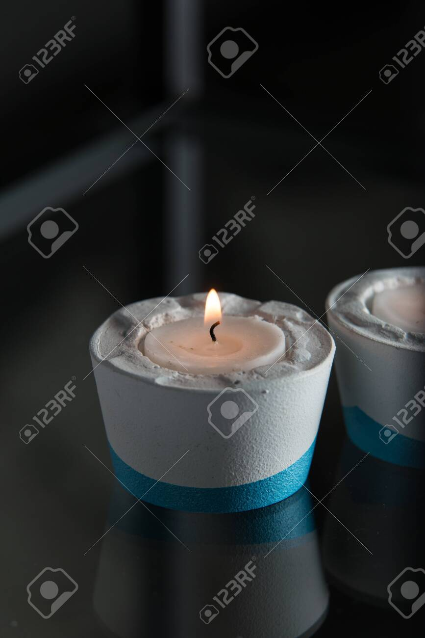 Two Candles In White And Blue Concrete Candle Holders Stock Photo Picture And Royalty Free Image Image 141757347
