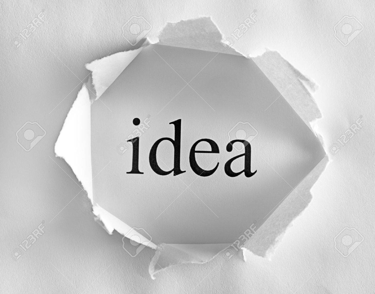 Idea on white background in a paper hole Stock Photo - 13023762