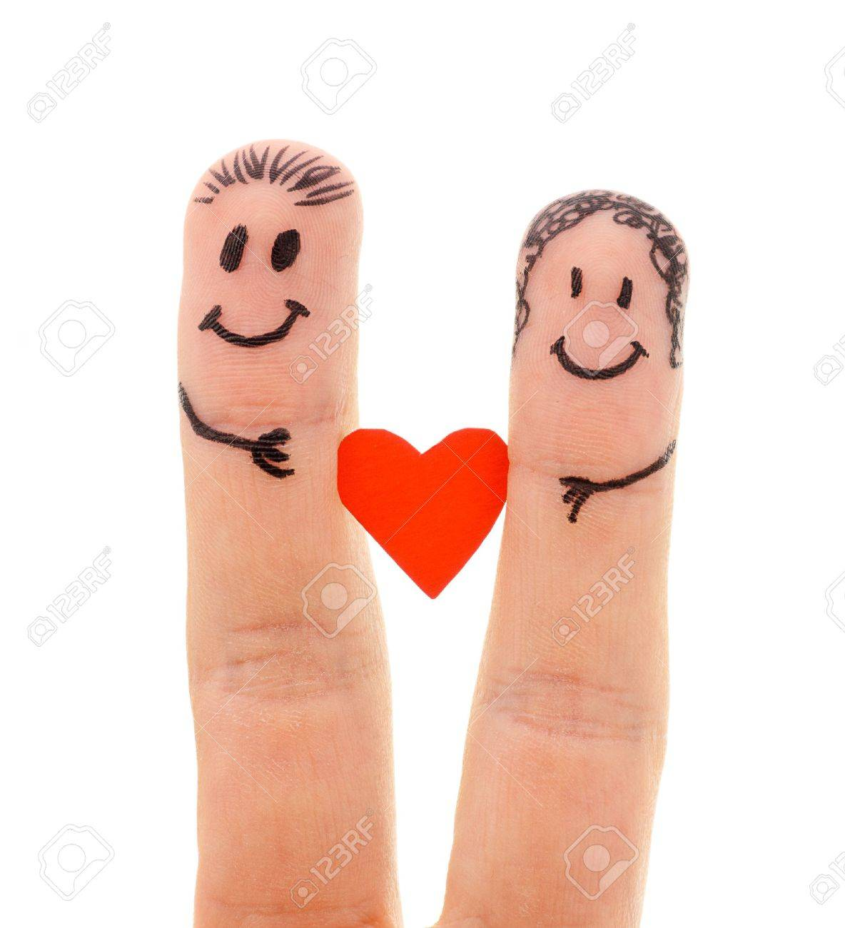 A happy couple in love with painted smiley and hugging isolated on white background - 13023743