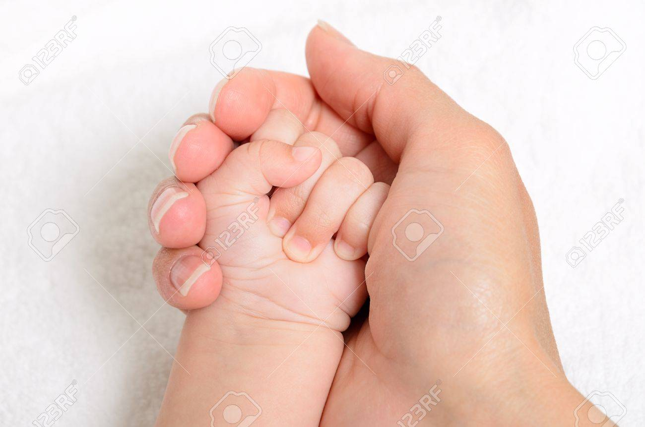 Mother holding a baby hand, extreme closeup Stock Photo - 15826008