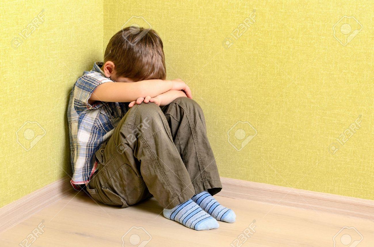 Little child boy wall corner punishment sitting - 16826605