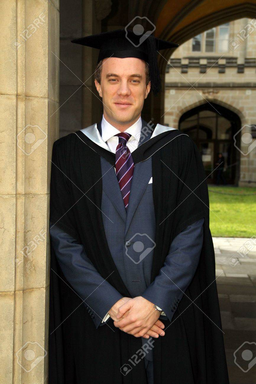 A Portrait Of A Young European Man In A Graduation Gown. Stock Photo ...