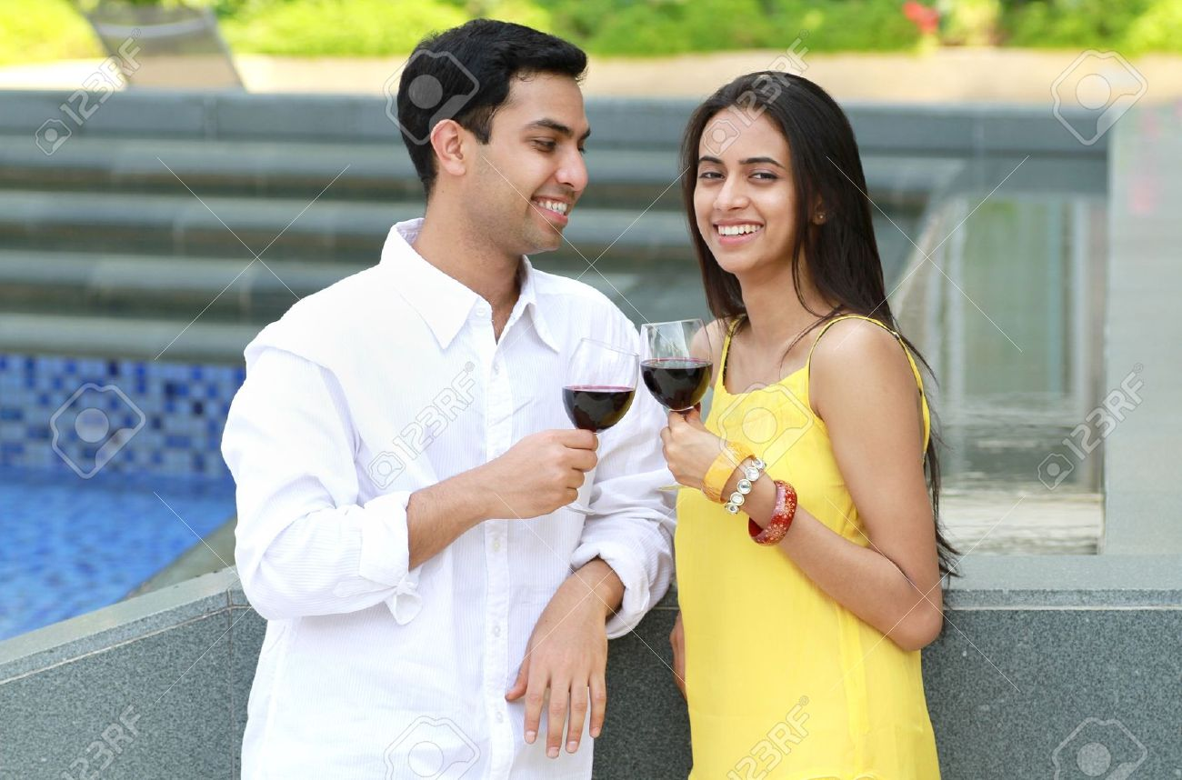 Young romantic couple celebrating with wine. Stock Photo - 9108181