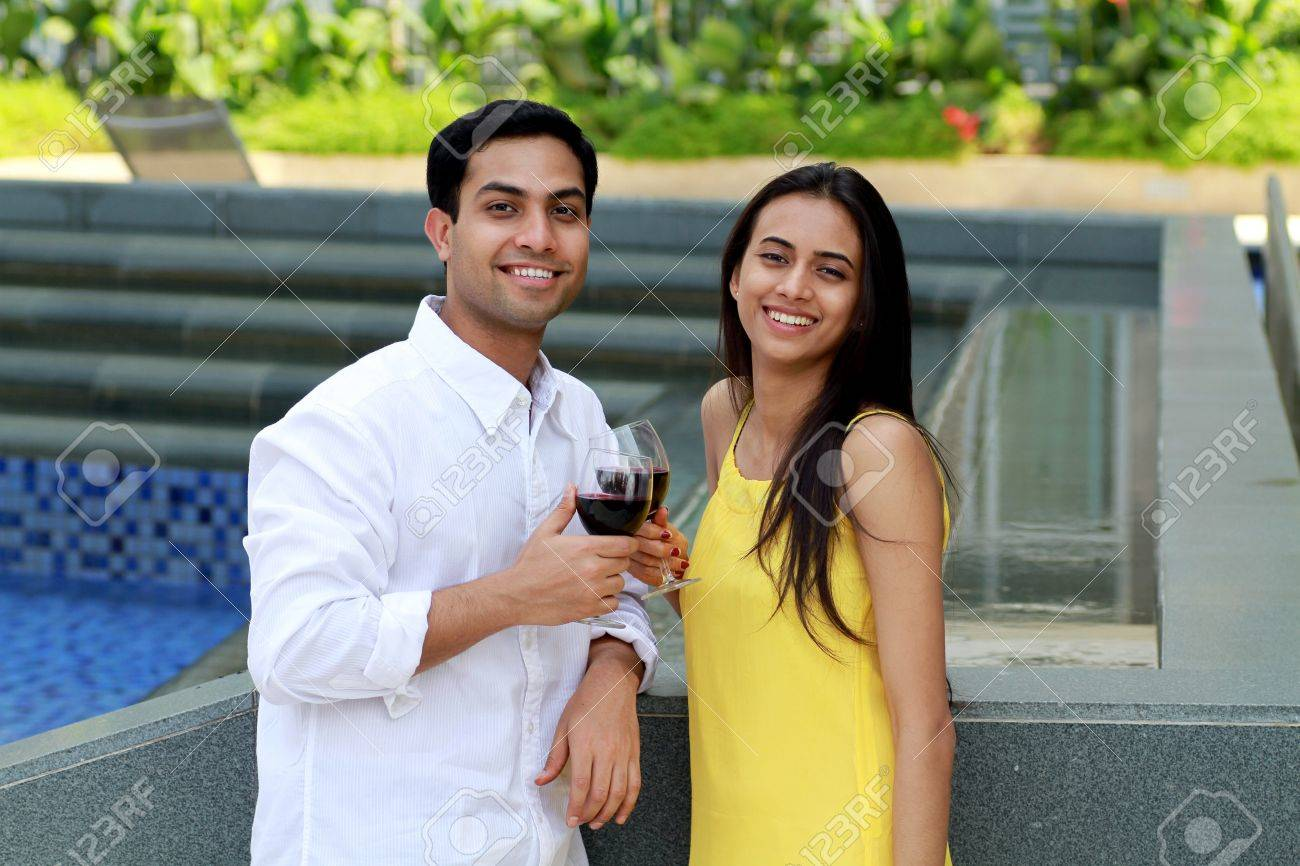 Young romantic couple celebrating with wine. Stock Photo - 9108182