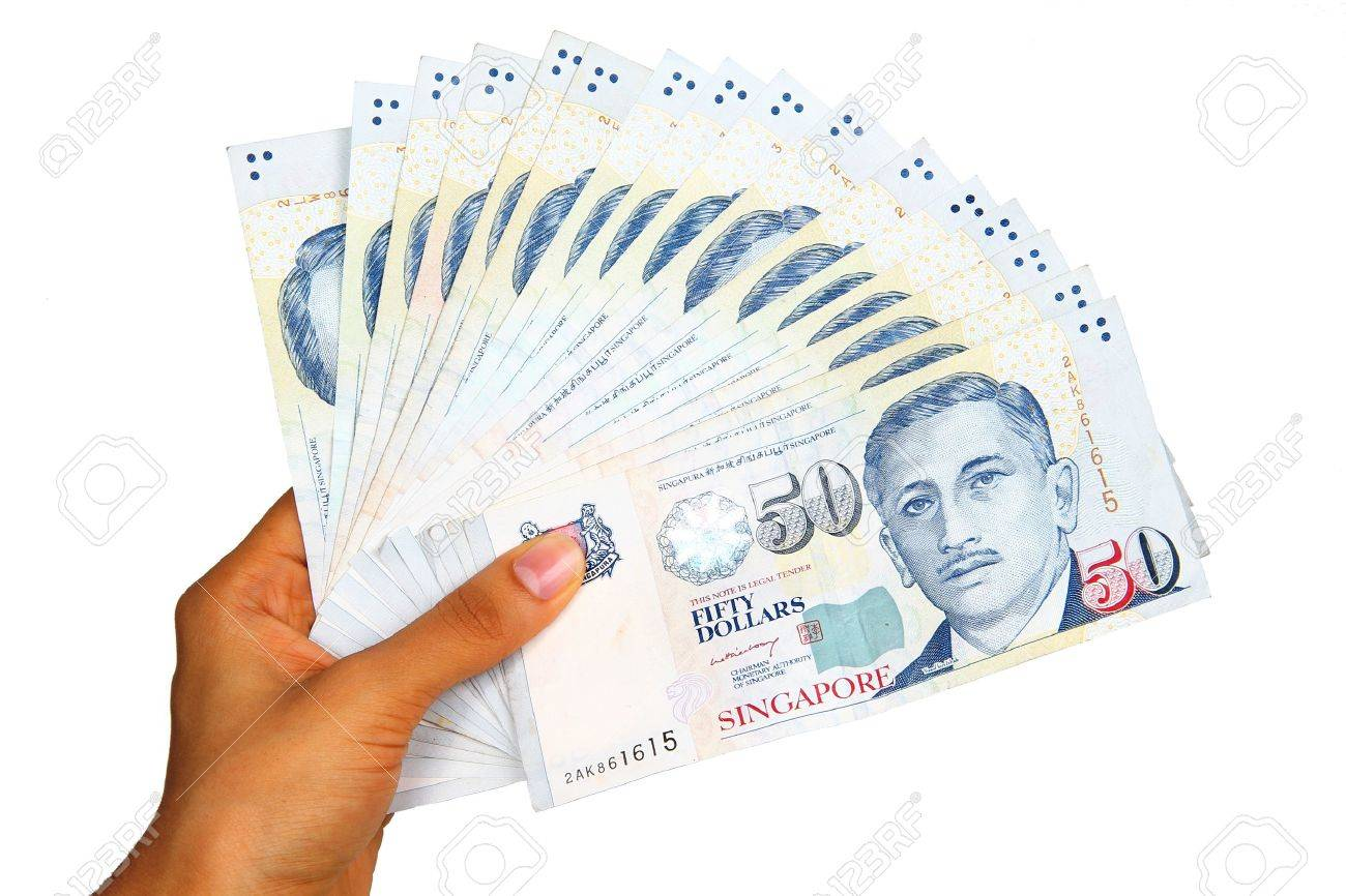 Singapore currency isolated on white background. Stock Photo - 9185735