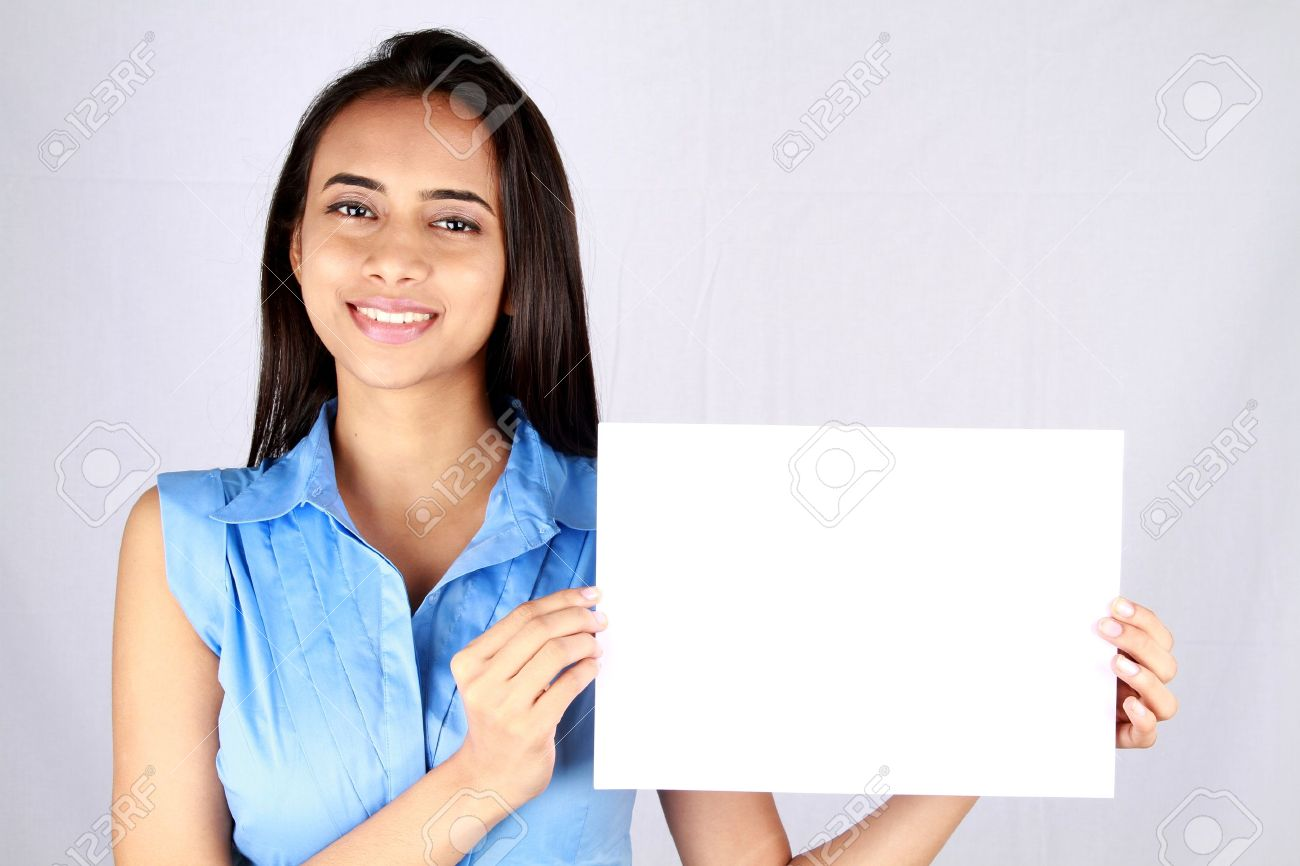 Young business woman holding empty white board. Stock Photo - 9628295
