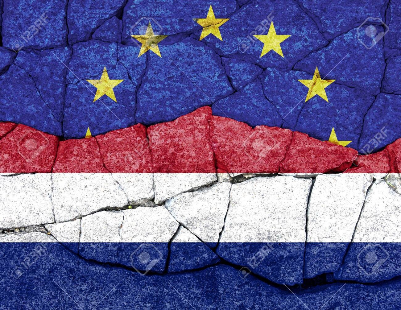 flags of EU and Netherlands painted on cracked wall - 122374717