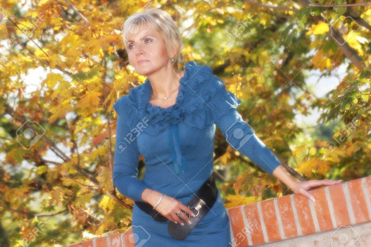 pretty mature lady outdoor stock photo, picture and royalty free