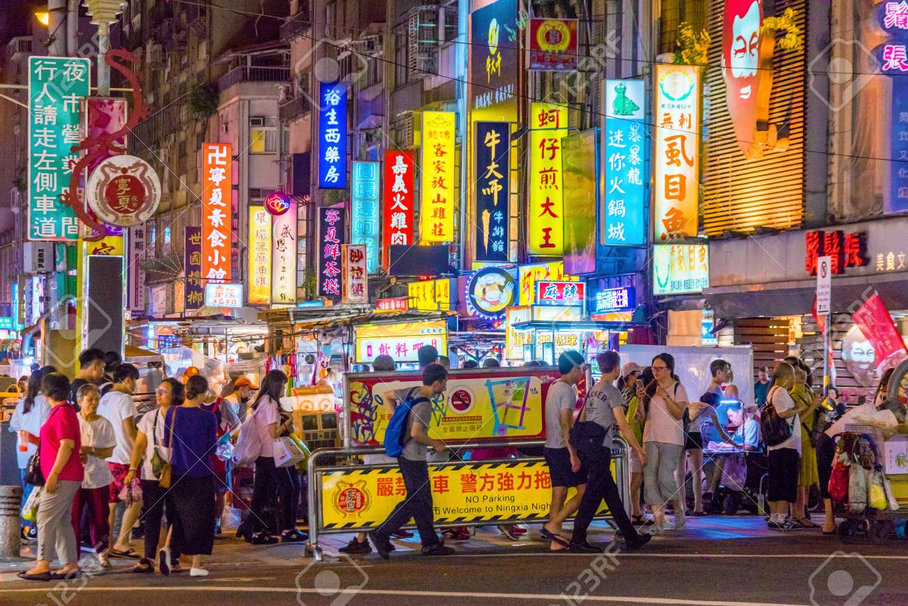 TAIPEI, TAIWAN - JULY 14: This is Ningxia night market a famous night market which has many local street food vendors and is situated in the downtown area of Zhongshan on July 14, 2017 in Taipei - 86933180