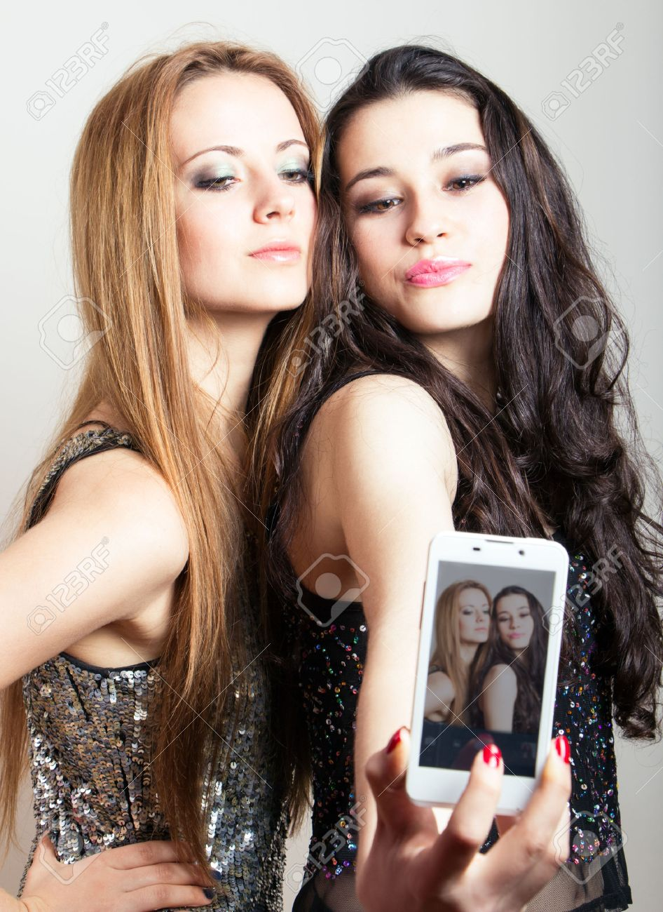 beautiful girls ready for a night out making a funny selfie with