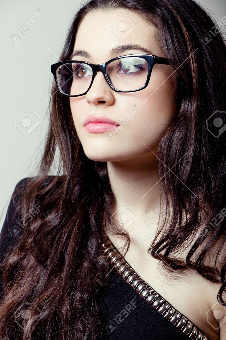 50bc59bf06d3 Beautiful girl with black rimmed glasses looking up Stock Photo - 28094565