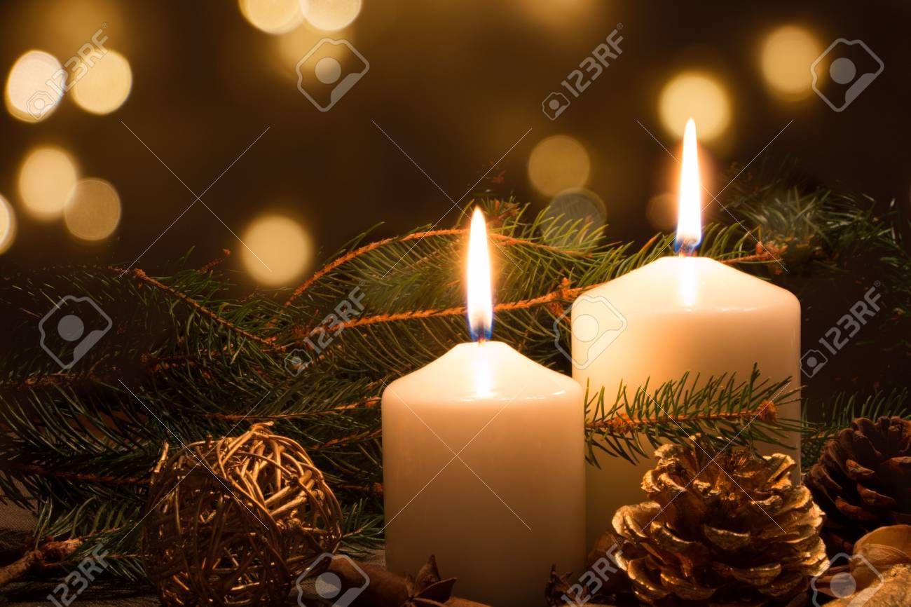 Christmas Candles.Christmas Candles And Ornaments Over Dark Background With Lights