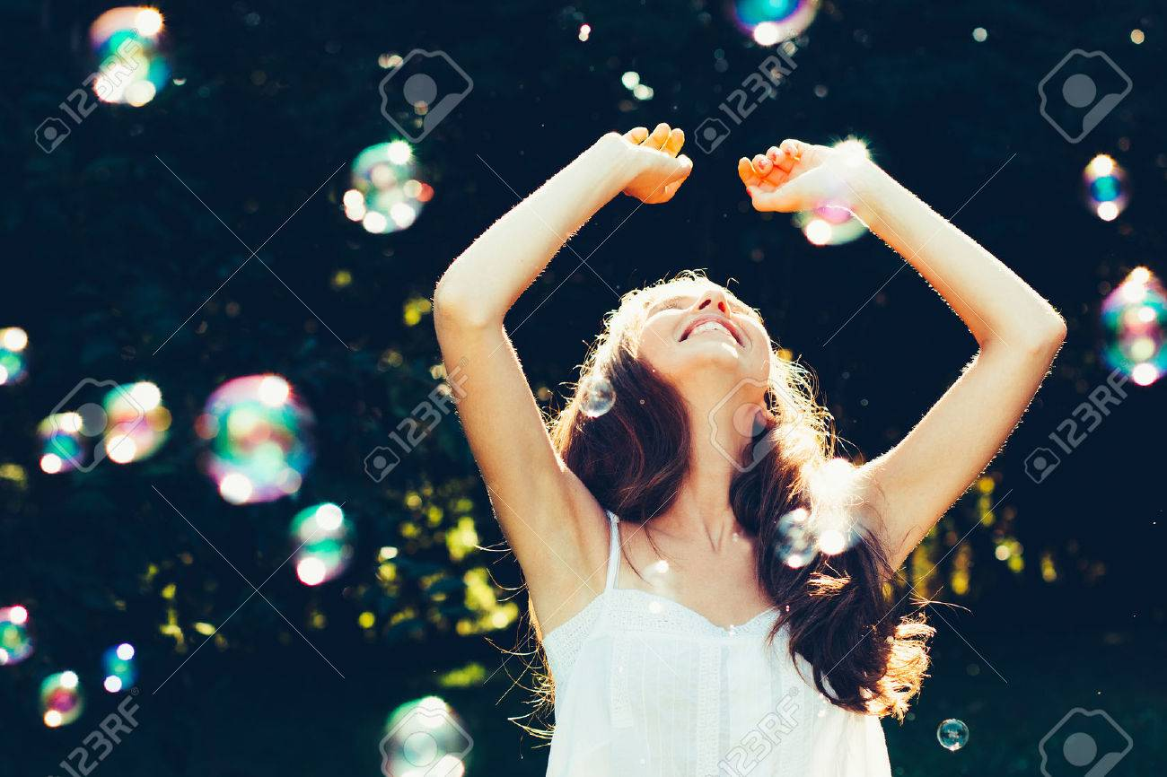 Young woman having fun with bubbles outdoors - 37880715