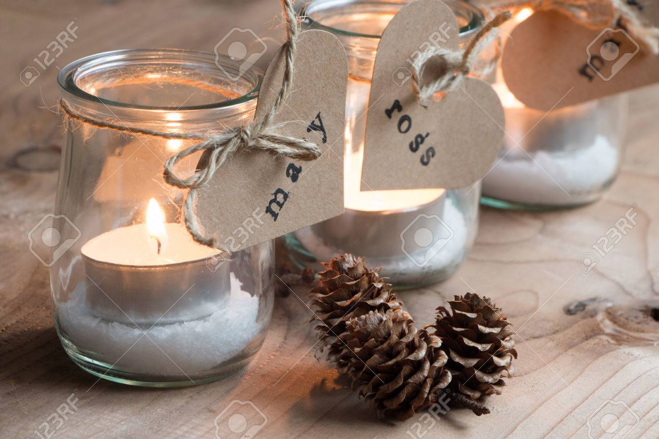 Customized eco candle holders with jars and paper labels printed for a Christmas dinner - 45588810
