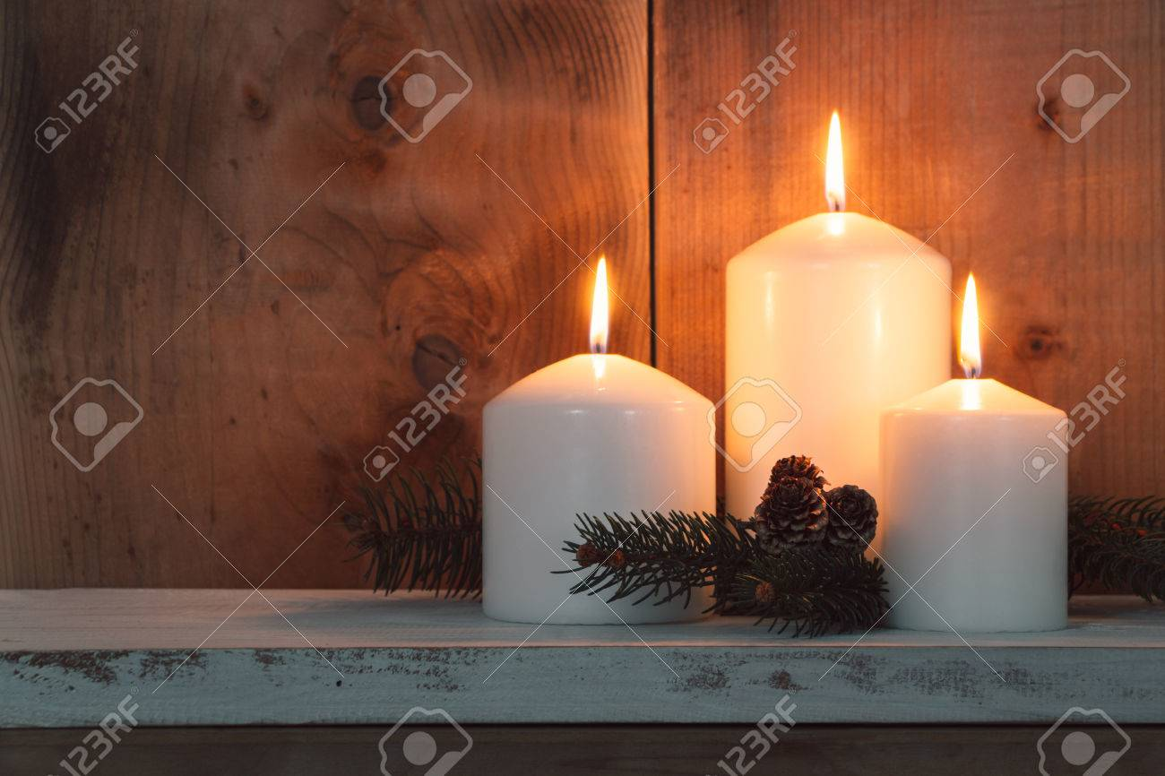Christmas candles and fir branches over wooden background - 46562441