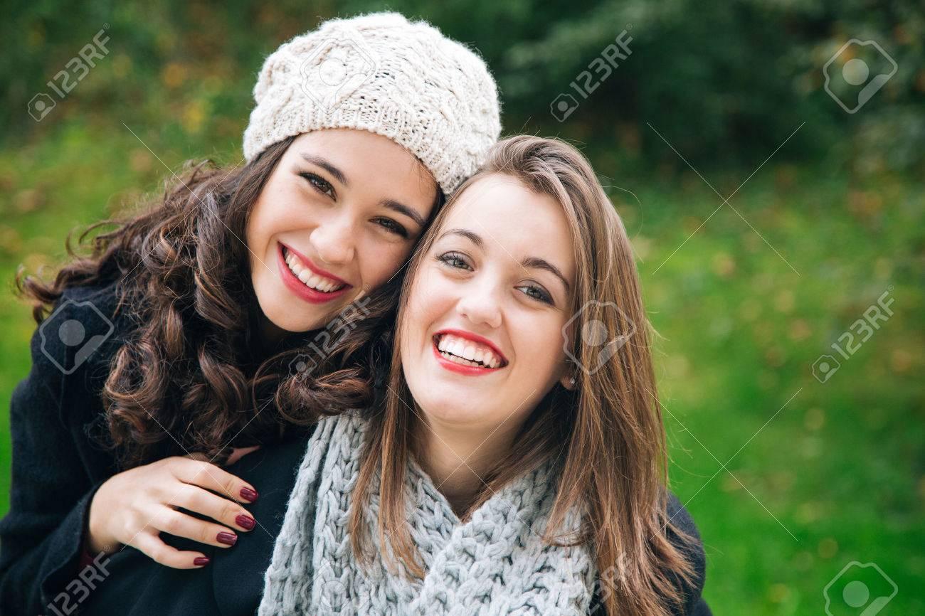 Cute best friend girls a piggyback in winter outdoors - 47210955